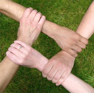 Photograph of team with joining hands